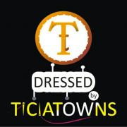 Dressed by Ticiatowns Logo